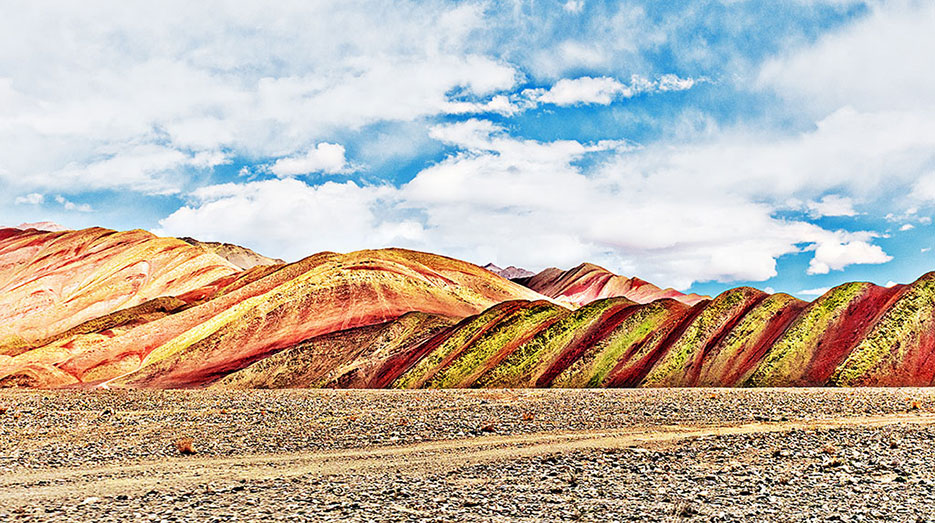 Buy a print of mountains that look like a cinnamon roll. Leh-Ladakh region, India as photographed by Naina Redhu