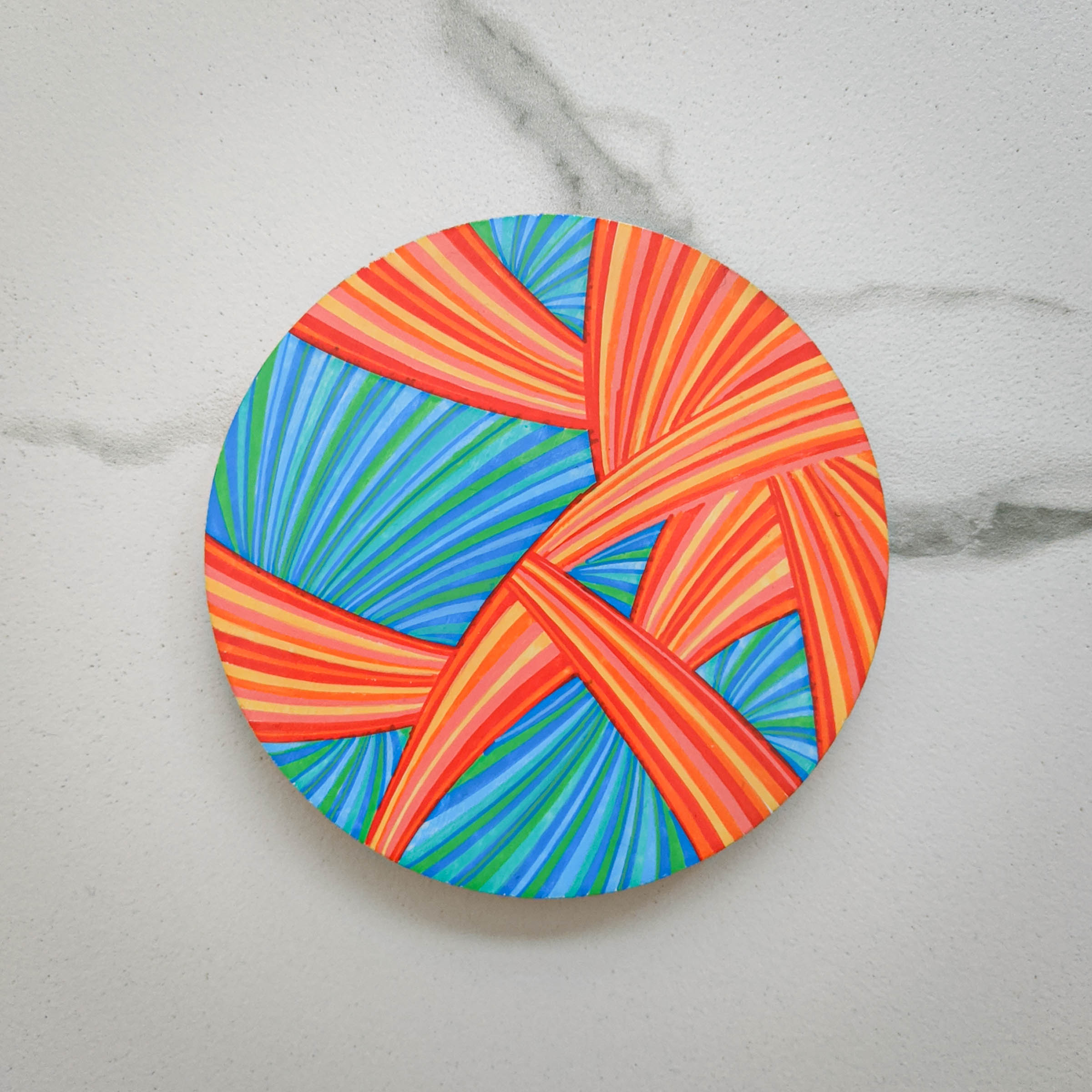 fish tail, saison de poisson, fish season, season of fish, line art, horizons, lines, red, blue, saffron, teal, khaosphilos, crimson, turquoise, crimson and turquoise, hand painted, wearable art, display art, original art, contemporary art, contemporary artist, naina redhu, naina.co, 3 inches diameter, 3 inch, circular canvas, acrylics on wood, wooden brooch, brooch, art brooch, wearable art brooch, wearable art jewellery, canvas display, magnet clasp, acrylic painting, khaos philos, chaos lover